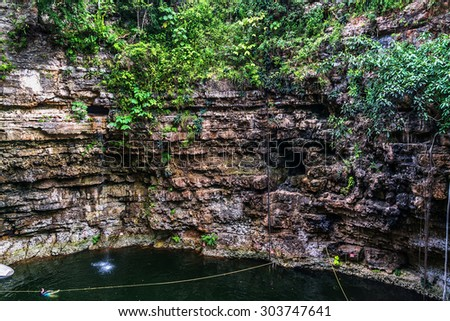 "Sacred Cenote (""sacred well"" or ""Well of Sacrifice""). Chichen Itza archaeological site, Yucatan peninsula, Mexico. - stock photo"