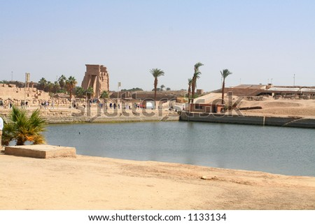 Sacred lake in Temple of Karnak, Egypt. The lake served for ritual purposes and for the purification of the priests. - stock photo