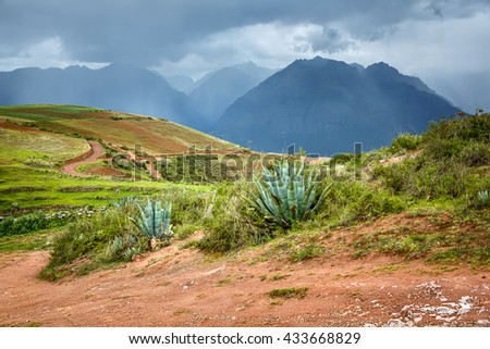 Sacred Valley of the Incas in the bad weather. View from ancient Inca circular terraces at Moray (agricultural experiment station) - Cusco Region, Peru, Latin America. - stock photo