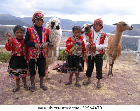SACRED VALLEY, PERU - JULY 25: Peruvian Children in traditional garments in the Sacred Valley, near Machu Picchu on July 25, 2006 - stock photo