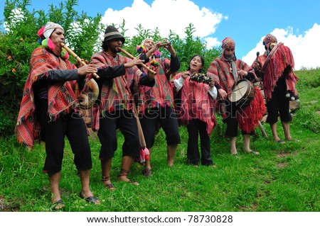 SACRED VALLEY, PERU - MARCH 09: Group of Peruvians in traditional dresses play musical instruments during peruvian wedding ceremony in Sacred Valley near Cuzco, Peru on March 09, 2010. - stock photo