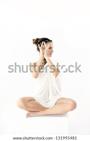 Sacred Woman holding her hands in a divine mudra. - stock photo