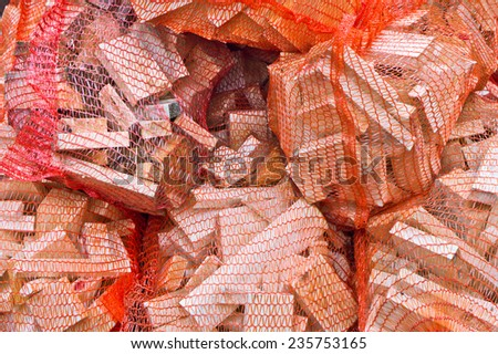Sacs of firewood kindling as background - stock photo