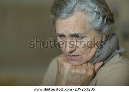 Sad aged woman - stock photo