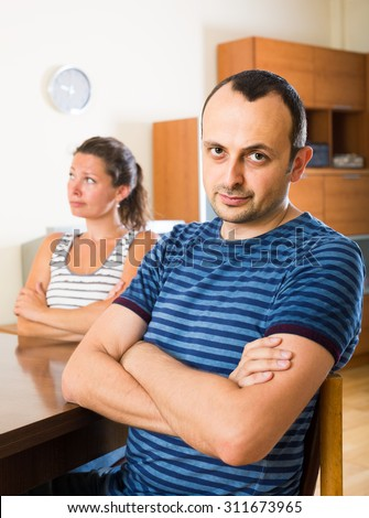 sad american family couple shouting while arguing indoors  - stock photo