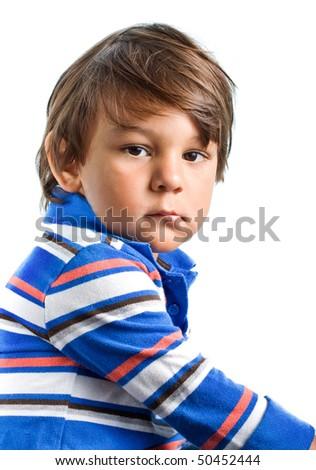 Sad and angry Hispanic child portrait isolated on white background - stock photo