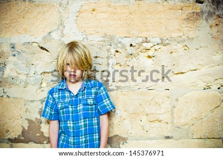 Sad and bullied lonely child - stock photo