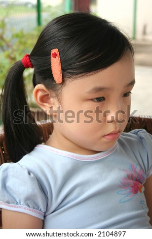 Sad and day-dreaming girl in a daze - stock photo