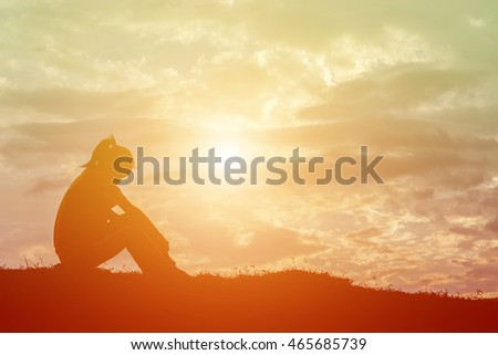 Sad and depressed woman sitting alone