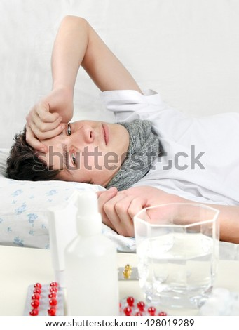 Sad and Sick Young Man on the Bed - stock photo