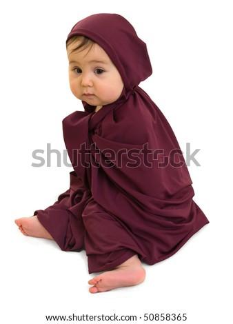 Sad baby girl sitting in purple muslim dress - stock photo