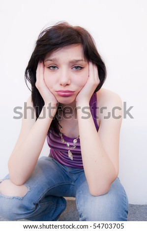 Sad Beautiful Brunette Girl with purple camisole - stock photo