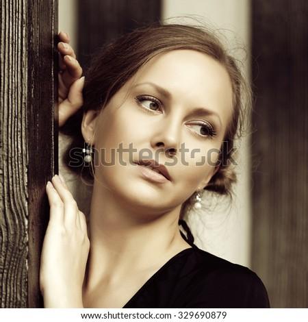 Sad beautiful fashion woman at the wall - stock photo