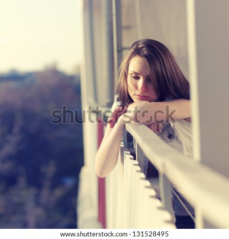 sad beautiful girl, enjoying the freshness of the evening - stock photo