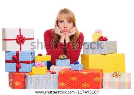 sad beautiful young woman and a pile of gift boxes. isolated on white background