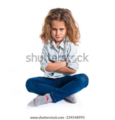 Sad blond baby girl - stock photo