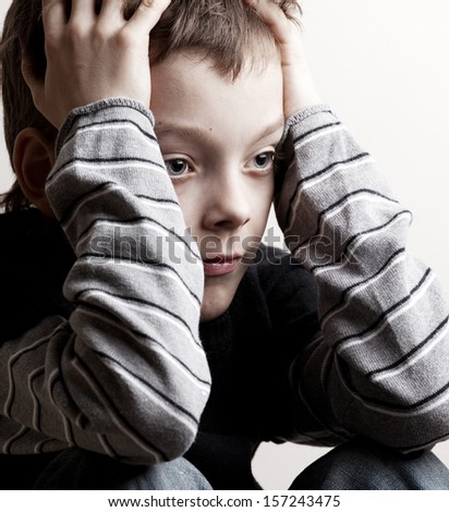 Sad boy. Depressed teenager at home. Problems at family - stock photo