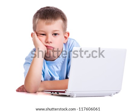 sad boy on a white background with a laptop