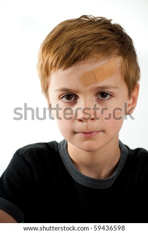 Sad Boy with Band Aid on His Forehead - stock photo