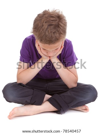 sad boy with drooping head white background - stock photo