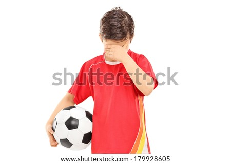 Sad boy with soccer ball isolated on white background - stock photo