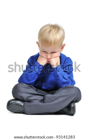 Sad boy with suit sitting in lotus pose isolated - stock photo