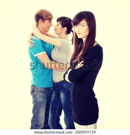 Sad brunette girl jealousy about her friend. - stock photo