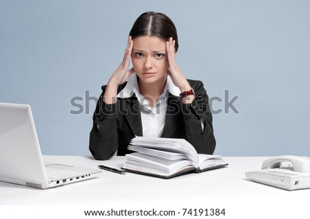 Sad business woman in office working with white table, laptop and diary personal organizer. Crisis! - stock photo