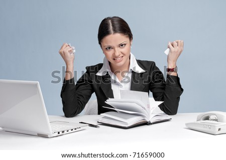 Sad business woman in office working with white table, laptop and diary personal organizer. Fury! - stock photo