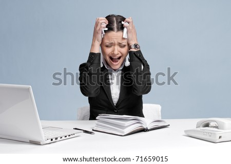 Sad business woman in office working with white table, laptop and diary personal organizer. Problem! - stock photo