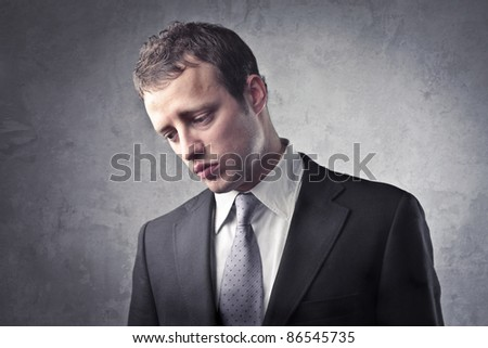 Sad businessman - stock photo