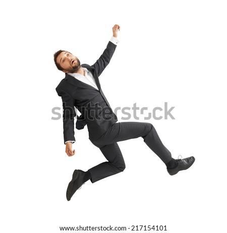 sad businessman falling down over white background - stock photo