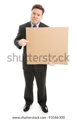 Sad businessman holding cardboard sign, ready for your text.  Full body isolated on white. - stock photo