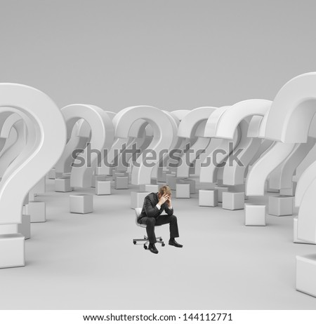 sad businessman sitting on chair with 3d questions - stock photo