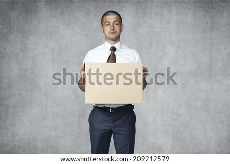 sad businessman with box - stock photo