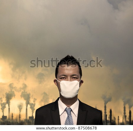 sad businessman with  mask and air pollution concept - stock photo
