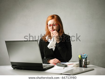 Sad businesswoman crying in front of a laptop - stock photo