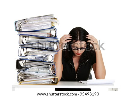 Sad businesswoman sitting behind the desk, isolated on white background - stock photo