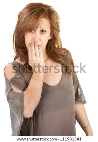 Sad Caucasian female with hand over mouth - stock photo