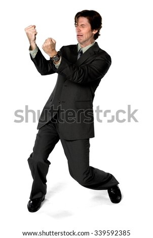 Sad Caucasian man with short dark brown hair in business formal outfit being in boxing stance - Isolated