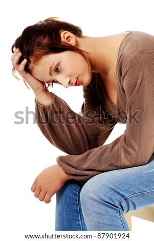 Sad caucasian pretty teen student thinking and touching her head. - stock photo