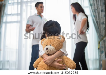 Sad child from this father and mother arguing, family negative concept. - stock photo