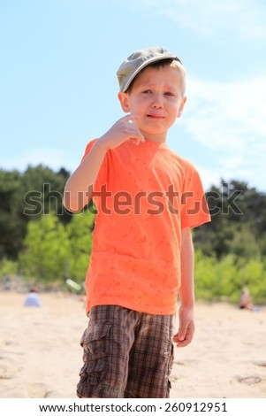 Sad child. Portrait of crying unhappy little boy outdoor - stock photo