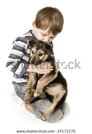 Sad child with puppy - stock photo