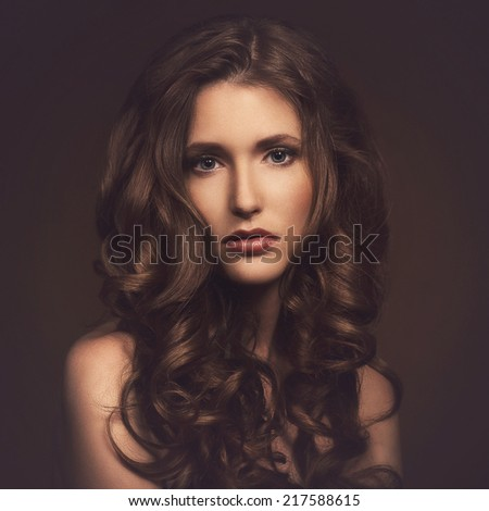 Sad, cute woman on a brown background - stock photo
