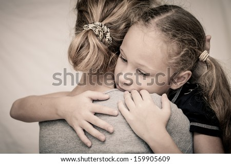sad daughter hugging his mother - stock photo