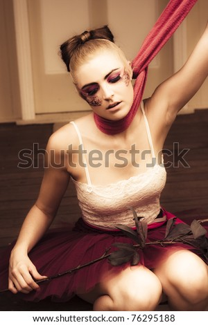 Sad Depressed And Lonely Woman Sits With A Flower On Her Lap And A Scarf Choking Her Out Of Breath, In A Lost Abandoned And Broken Heart Concept - stock photo