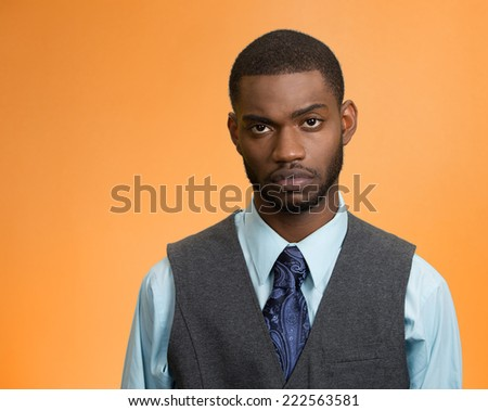 Sad, depressed, defeated. Closeup portrait gloomy, alone disappointed business man isolated on orange  background. Negative human facial expressions, emotions, feelings, life perception, body language - stock photo