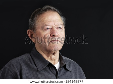 Sad, depressed or deep in thoughts senior old man - stock photo