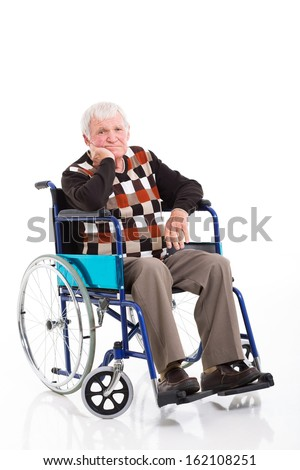 sad disabled senior man sitting on a wheelchair over white background - stock photo
